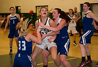 Newfound's Amanda Johnston gets pressured by Jordan Wall and Madison Dow of Somersworth during NHIAA Division III basketball on Thursday evening.  (Karen Bobotas/for the Laconia Daily Sun)
