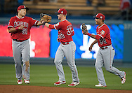 The Angels' Ji-Man Choi, Todd Cunningham and Rafael Ortega celebrate after the Angels' Freeway Series game against the Dodgers Thursday night at Dodger Stadium.<br /> <br /> ///ADDITIONAL INFO:   <br /> <br /> freeway.0401.kjs  ---  Photo by KEVIN SULLIVAN / Orange County Register  --  3/31/16<br /> <br /> The Los Angeles Angels take on the Los Angeles Dodgers at Dodger Stadium during the Freeway Series Thursday.<br /> <br /> <br />  3/31/16