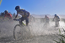 ROBERTSON, SOUTH AFRICA - MARCH 20: With Manuel Fumic leading, riders cross a river during stage two's 110km from Robertson on March 20, 2018 in Cape Town, South Africa. Mountain bikers from across South Africa and internationally gather to compete in the 2018 ABSA Cape Epic, racing 8 days and 658km across the Western Cape with an accumulated 13 530m of climbing ascent, often referred to as the 'untamed race' the Cape Epic is said to be the toughest mountain bike event in the world. (Photo by Dino Lloyd)
