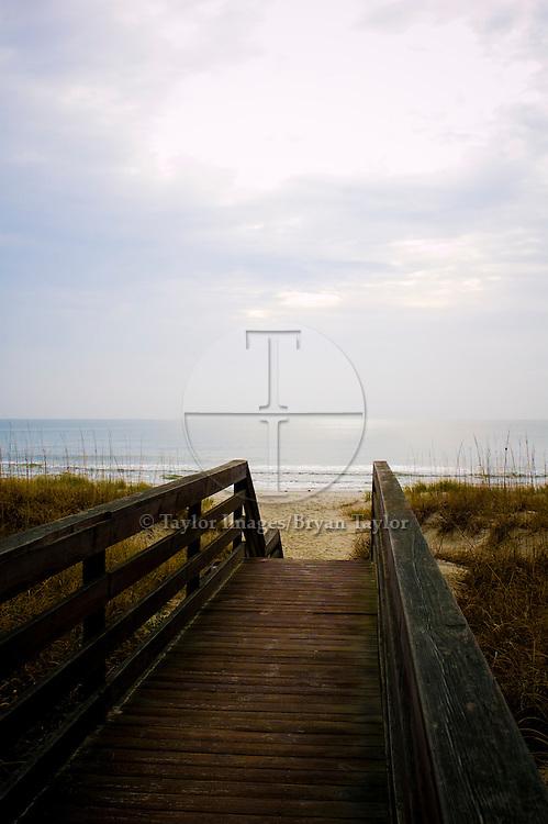 Boardwalk over dunes to beach in Pawleys Island, South Carolina.