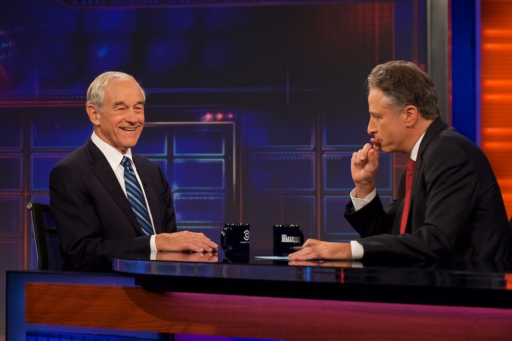 """Host Jon Stewart and Republican Presidential candidate Ron Paul appear on set during Comedy Central's """"The Daily Show with Jon Stewart"""" in New York City."""