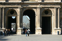Archway and glass pyramid at the Louvre, Paris, France<br />