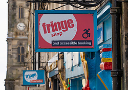 Detail of signs outside the Fringe Shop on the Royal Mile in Edinburgh, Scotland, UK