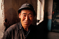 """A coalminer near Datong, a main coal producing area in northern China, 1993<br /> Available as Fine Art Print in the following sizes:<br /> 08""""x12""""US$   100.00<br /> 10""""x15""""US$ 150.00<br /> 12""""x18""""US$ 200.00<br /> 16""""x24""""US$ 300.00<br /> 20""""x30""""US$ 500.00"""