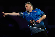 Michael Barnard throwing the dart to win the match, during the PDC World Championship darts at Alexandra Palace, London, United Kingdom on 14 December 2018.