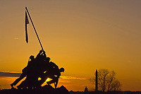 The Iwo Jima Memorial at sunrise (in Arlington, VA.), with the U. S. Capitol and Washington Monument in background, Washington D.C.