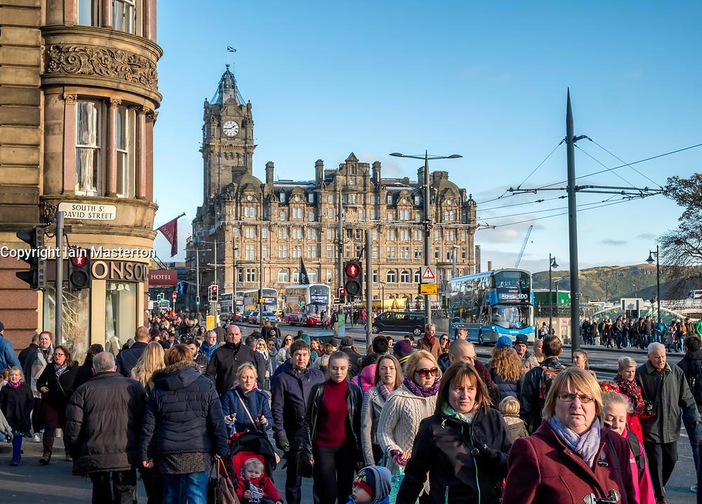 Busy pedestrian crossing on Princes Street in central Edinburgh, Scotland, United Kingdom,.