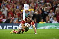 Lloyd Williams  of Wales runs in and scores a try in 2nd half . Rugby World Cup 2015 pool A match, Wales v Uruguay at the Millennium Stadium in Cardiff, South Wales  on Sunday 20th September 2015.<br /> pic by  Andrew Orchard, Andrew Orchard sports photography.