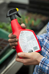 Reading a label on a chemical spray