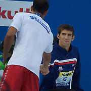 Michael Phelps, USA, is congratulated by Milorad Cavic, Serbia after winning the men's 100m Butterfly at the World Swimming Championships in Rome on Saturday, August 01, 2009. Photo Tim Clayton