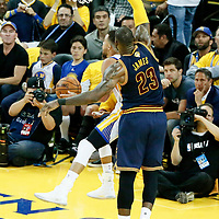 01 June 2017: Golden State Warriors guard Stephen Curry (30) goes for the reverse layup past Cleveland Cavaliers forward LeBron James (23) during the Golden State Warriors 113-90 victory over the Cleveland Cavaliers, in game 1 of the 2017 NBA Finals, at the Oracle Arena, Oakland, California, USA.