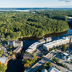 Mill buildings at the dam on the Lamprey River in downtown Newmarket, New Hampshire. Great Bay is visible in the distance.