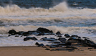 Photo of waves crashing into a jetty on Spring Lake Beach