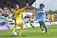 Coventry City defender Junior Brown (12) comes in to tackle Oxford United midfielder James Henry (17)  during the EFL Sky Bet League 1 match between Oxford United and Coventry City at the Kassam Stadium, Oxford, England on 9 September 2018.