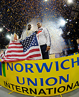 Photo: Richard Lane.<br />Norwich Union International, Glasgow. 27/01/2007. <br />USA captain Kenta Bell and Great Britain captain, Jason Gardener hold the trophy after finishing the meeting on equal points.