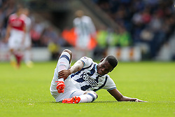Jonathan Leko of West Bromwich Albion goes down injured - Rogan Thomson/JMP - 28/08/2016 - FOOTBALL - The Hawthornes - West Bromwich, England - West Bromwich Albion v Middlesbrough - Premier League.