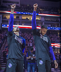 February 3, 2018 - Sacramento, CA, USA - The Sacramento Kings' George Hill and Garrett Temple raise their fists in the air after the national anthem was played before a game against the Dallas Mavericks at the Golden 1 Center in Sacramento Calif., on Saturday, Feb. 3, 2018. (Credit Image: © Hector Amezcua/TNS via ZUMA Wire)