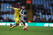 Sheffield Utd's Ryan Flynn battles with Aston Villa's Antonio Luna during the FA Cup with Budweiser, 3rd round, Aston Villa v Sheffield Utd match  at Villa Park in Birmingham, England on Saturday 4th Jan 2014.<br /> pic by Jeff Thomas, Andrew Orchard sports photography.