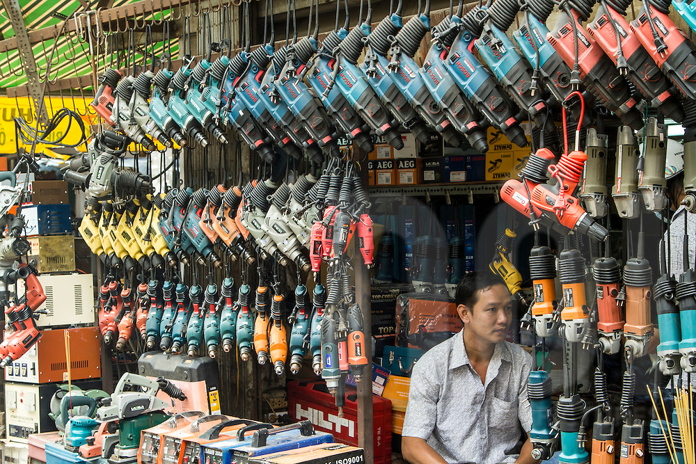 Drills lined up in a hardware shop of Cholon market, Ho Chi Minh City, Vietnam, Southeast Asia