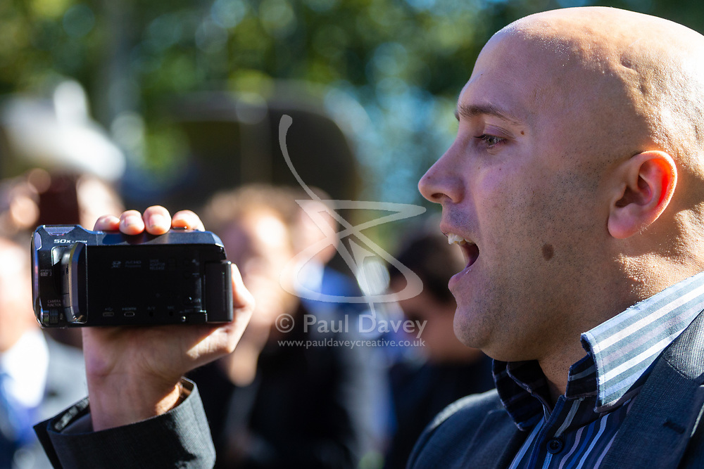 A protester claiming to be a journalist causes Bellingcat investigative journalists of working for NATO at a press conference on College Green opposite the Houses of Parliament. London, October 09 2018.