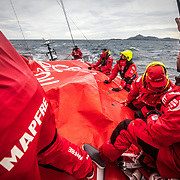 Leg 7 from Auckland to Itajai, day 12 on board MAPFRE, Sailors putting down the main sail damaged, 29 March, 2018.