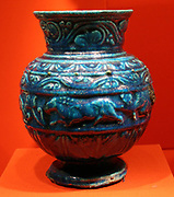 Three decorated jars, 1st c A.D. Stately bicolour faience vessels with fine leafy ornament have been found fairly frequently in Alexandria, the Fayum towns and Middle Egypt.
