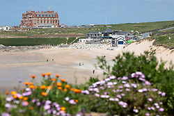 """© Licensed to London News Pictures. 11/05/2020. Newquay, UK. Fistral beach on the North coast of Cornwall seen nearly empty, the day after British Prime Minister Boris Johnson announced a 'road map' to lift lockdown restrictions due to Covid-19, (Coronavirus). A rise in """"staycations"""" - the concept of holidaying in your home country rather than travelling abroad - is expected, with many visitors planning to visit Cornwall. However, an ongoing campaign titled """"#ComeBackLater"""" is trying to persuade tourists not to visit the county until it is safe to do so. Photo credit : Tom Nicholson/LNP"""