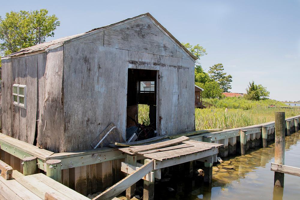 Decrepit, abandoned crab shack on water's edge
