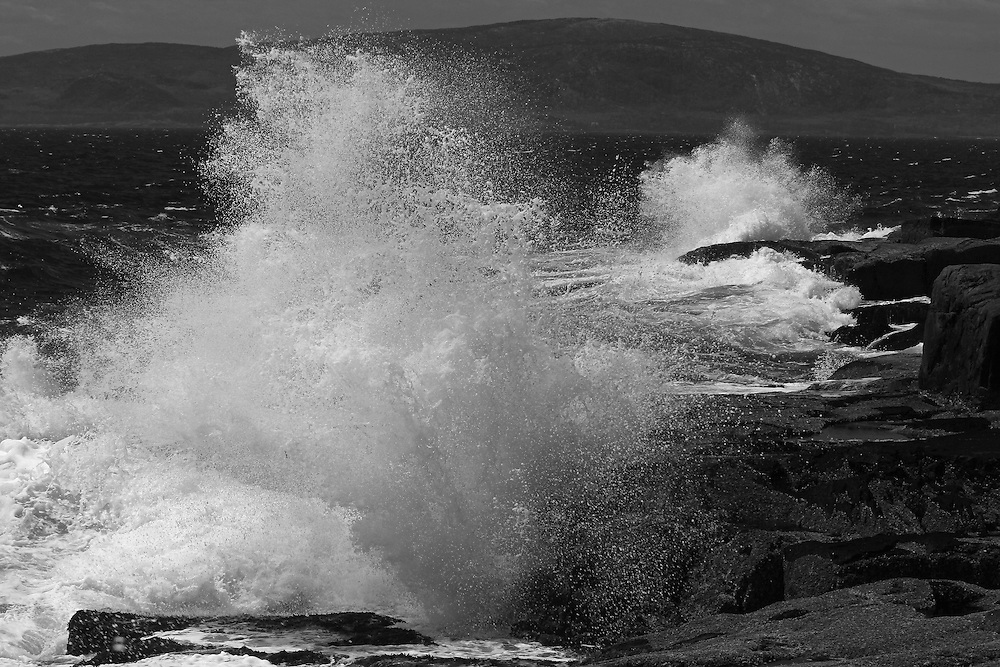 The Schoodic Peninsula is the only part of Acadia National Park that is on the mainland. It provides great coastal scenery with dramatic views but without the large crowds of Mount Desert Island. This is a wave crashing into Schoodic Point and splashing across the seascape. <br /> <br /> This Maine coastal B&W photography image is available as museum quality photography prints, canvas prints, acrylic prints or metal prints. Black and white photography fine art prints may be framed and matted to the individual liking and decorating needs:<br /> <br /> http://juergen-roth.pixels.com/featured/maine-schoodic-peninsula-juergen-roth.html<br /> <br /> All photographs are available for digital and print image licensing at www.RothGalleries.com. Please contact me direct with any questions or request.<br /> <br /> Good light and happy photo making!<br /> <br /> My best,<br /> <br /> Juergen<br /> Prints: http://www.rothgalleries.com<br /> Photo Blog: http://whereintheworldisjuergen.blogspot.com<br /> Twitter: @NatureFineArt<br /> Instagram: https://www.instagram.com/rothgalleries<br /> Facebook: https://www.facebook.com/naturefineart