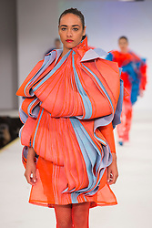 © Licensed to London News Pictures. 01/06/2015. London, UK. Collection by Melissa Obika. Fashion show of the Manchester School of Art at Graduate Fashion Week 2015. Graduate Fashion Week takes place from 30 May to 2 June 2015 at the Old Truman Brewery, Brick Lane. Photo credit : Bettina Strenske/LNP