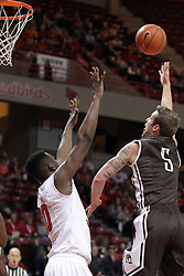 29 December 2014: Scottie Bruxvoort hooks a shot over the arms of John Jones  during an NCAA non-conference interdivisional exhibition game between the Quincy University Hawks and the Illinois State University Redbirds at Redbird Arena in Normal Illinois.
