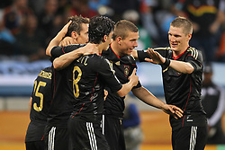 03.07.2010, CAPE TOWN, SOUTH AFRICA, Miroslav Klose, Mesut Oezil, Lukas Podolski and Bastian Schweinsteiger of Germany celebrate Germany's fourth goal during the Quarter Final, Match 59 of the 2010 FIFA World Cup, Argentina vs Germany held at the Cape Town Stadium EXPA Pictures © 2010, PhotoCredit: EXPA/ nph/  Kokenge