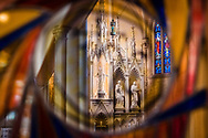 The reredos is seen through stained glass on Saturday, Jan. 16, 2021, at Zion Lutheran Church, Fort Wayne, Indiana. LCMS Communications/Erik M. Lunsford