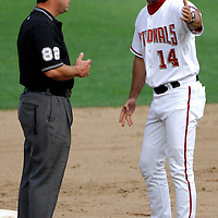 21 July 2007:  Washington Nationals manager Manny Acta (14) argues with second base umpire Rob Drake (82) after third baseman Ryan Zimmerman was called out on a pick off play at second base in the 6th inning.  The Nationals defeated the Rockies 3-0 at RFK Stadium in Washington, D.C.  ****For Editorial Use Only****