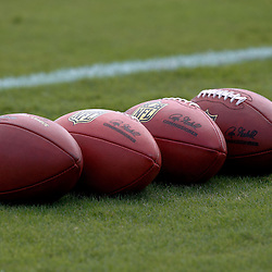 July 29, 2011; Metairie, LA, USA; A detailed view of footballs on the field during the first day of training camp at the New Orleans Saints practice facility. Mandatory Credit: Derick E. Hingle