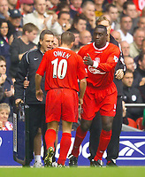 Photo. Jed Wee.<br /> Liverpool v Arsenal, FA Barclaycard Premiership, Anfield, Liverpool. 04/10/03.<br /> Liverpool's Michael Owen (L) leaves the field injured as he is replaced by Emile Heskey.