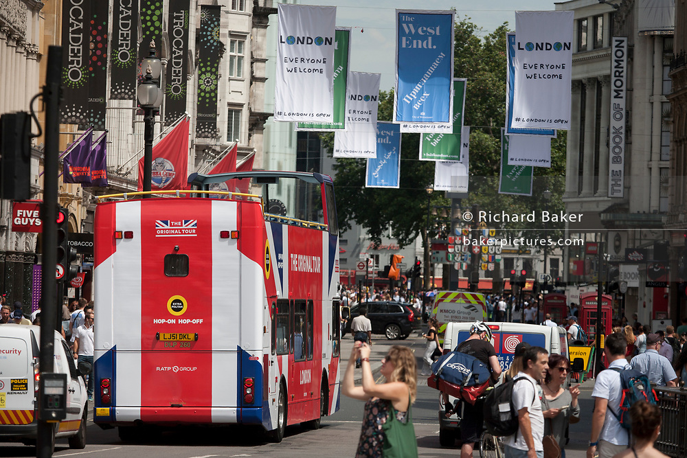 A tour bus with The Original Tour drives along Coventry Street on its route through central London, on 7th July 2017, in London.