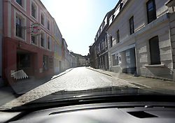 23 March 2020. Montreuil Sur Mer, Pas de Calais, France. <br /> Coronavirus - COVID-19 in Northern France.<br /> <br /> Eerily deserted streets of the ancient citadel town of Montreuil Sur Mer, the former headquarters of the British Army during WW1. French lawmakers have imposed strict controls on the movement of people in an effort to stem the spread of the virus. Anyone leaving their home must carry with them an 'attestation,' in a effect a self administered permit to allow them out of the house. If stopped by the police, one must produce a valid permit along with identification papers. Failure to do so is punishable with heavy fines. Movement in France has been heavily restricted by the government.<br /> <br /> Montreuil Sur Mer was the headquarters of the British Army under Field-Marshal Sir Douglas Haig from March 1916 to April 1919. Over 1,200 year old, the ancient fortified  town with its high ramparts has endured through history, surviving the plague and King Henry VIII's invasion of France in 1544 when the Duke of Norfolk under Henry VIII's command laid a disastrous siege to the town which held firm until Norfolk was forced to withdraw in 1545. Residents are confident the ancient town can survive the coronavirus too. <br /> Photo©; Charlie Varley/varleypix.com
