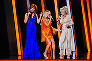 NASHVILLE, TENNESSEE - NOVEMBER 13: (FOR EDITORIAL USE ONLY) (L-R) Reba McEntire, Carrie Underwood, and Dolly Parton perform onstage during the 53rd annual CMA Awards at the Music City Center on November 13, 2019 in Nashville, Tennessee.