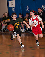 Gilmanton's Isaac Dandurand charges down court guarded by Lou Athanas/Laconia's Madison Kirker during the Championship game for the Junior Coed Division of the 19th Annual Francoeur Basketball Tournament Sunday morning at Gilford Middle School.  (Karen Bobotas/for the Laconia Daily Sun)