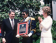 Michael Jackson receives a presidential award from President Ronald Reagan.  First Lady Nancy Reagan applauds.  May 14, 1984<br />Photo by Dennis Brack
