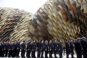 Policemen line up outside the Spain Pavilion at the site of the 2010 World Expo in Shanghai, China on 23 April 2010. The expo will begin on May 01. Shanghai eventually spent some 40 billion usd in developing the expo site and related infrastructure, and saw a record breaking 70 million visitors, the site has seen limited use after the end of the expo. Investment in government infrastructure and real estate spending have surpassed foreign trade as the biggest contributor to China's growth, fueling fears of an economic slow down triggered by the debt burden.