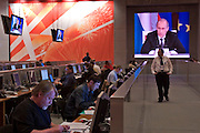 Moscow, Russia, 10/05/2005..Live video feed monitors in the International Press Centre display Russian President Vladimir Putin speaking at a press conference at the end of the Russia - European Union summit.