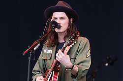© Licensed to London News Pictures. 26/06/2015. Pilton, UK.  James Bay performing on the The Pyramid Stage stage at Glastonbury Festival 2015 on Friday Day 3 of the festival.  This years headline acts include Kanye West, The Who and Florence and the Machine, the latter being upgraded in the bill to replace original headline act Foo Fighters.   Photo credit: Richard Isaac/LNP