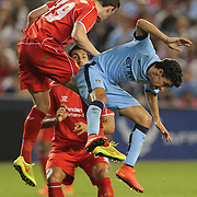 Jack Robinson, (left), Liverpool, heads clear from Jesús Navas, Manchester City, during the Manchester City Vs Liverpool FC Guinness International Champions Cup match at Yankee Stadium, The Bronx, New York, USA. 30th July 2014. Photo Tim Clayton