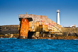 Lighthouse and deep seawater supply pipe of NELHA (National Energy Laboratory of Hawaii, USA Authority) at Keahole Point, the 1m (40') in diameter, 6,284 foot long pipeline caters 6ºC (43ºF) cold deep seawater from 2,000-foot depths to over 30 thriving enterprises in the industrial park, off Kona Coast, Big Island, Hawaii, USA, Pacific Ocean