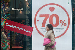 © licensed to London News Pictures. London, UK 13/02/2012. A shopper walking past a shop on the day before Valentine's Day in Oxford Street, London. Photo credit: Tolga Akmen/LNP