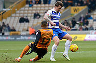 Simon Cox evades challenge from Rajiv Van La Perra during the Sky Bet Championship match between Wolverhampton Wanderers and Reading at Molineux, Wolverhampton, England on 7 February 2015. Photo by Alan Franklin.