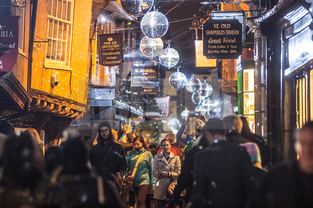 © Licensed to London News Pictures. 30/10/2015. York, UK. York's most famous street The Shambles is immersed in showers of light from 40 mirror balls as part of an installation by Marcus Beck & Simon Marco called Join the Revolution as part of the The tenth Illuminating York festival that has taken place in the city, the event runs from Wednesday to Saturday & will see 50,000 people visit the the city. Photo credit: Andrew McCaren/LNP