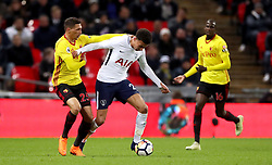 Watford's Jose Holebas (left) and Tottenham Hotspur's Dele Alli battle for the ball